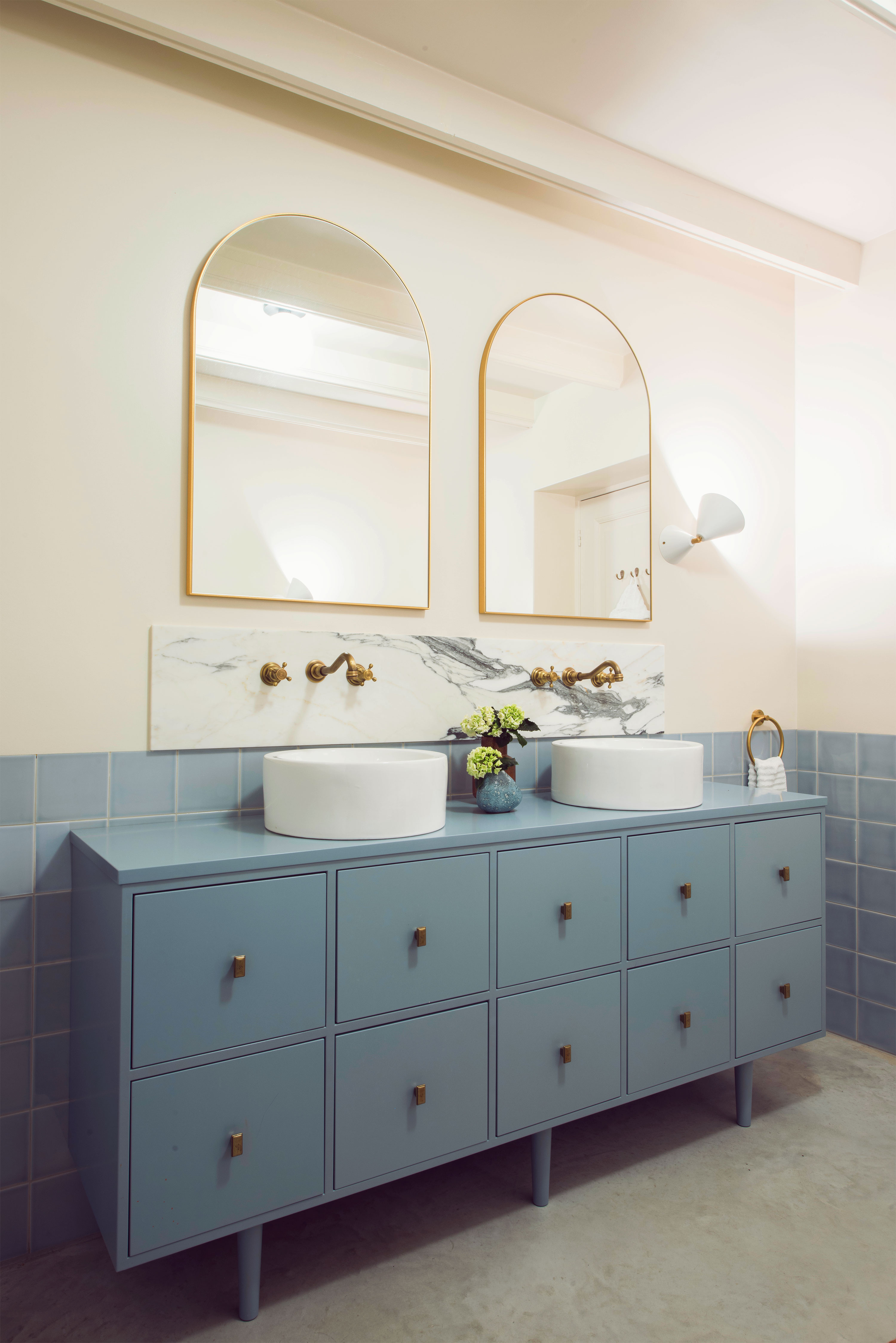 bathroom design studio 34 south blue bold concrete arch mirror brass