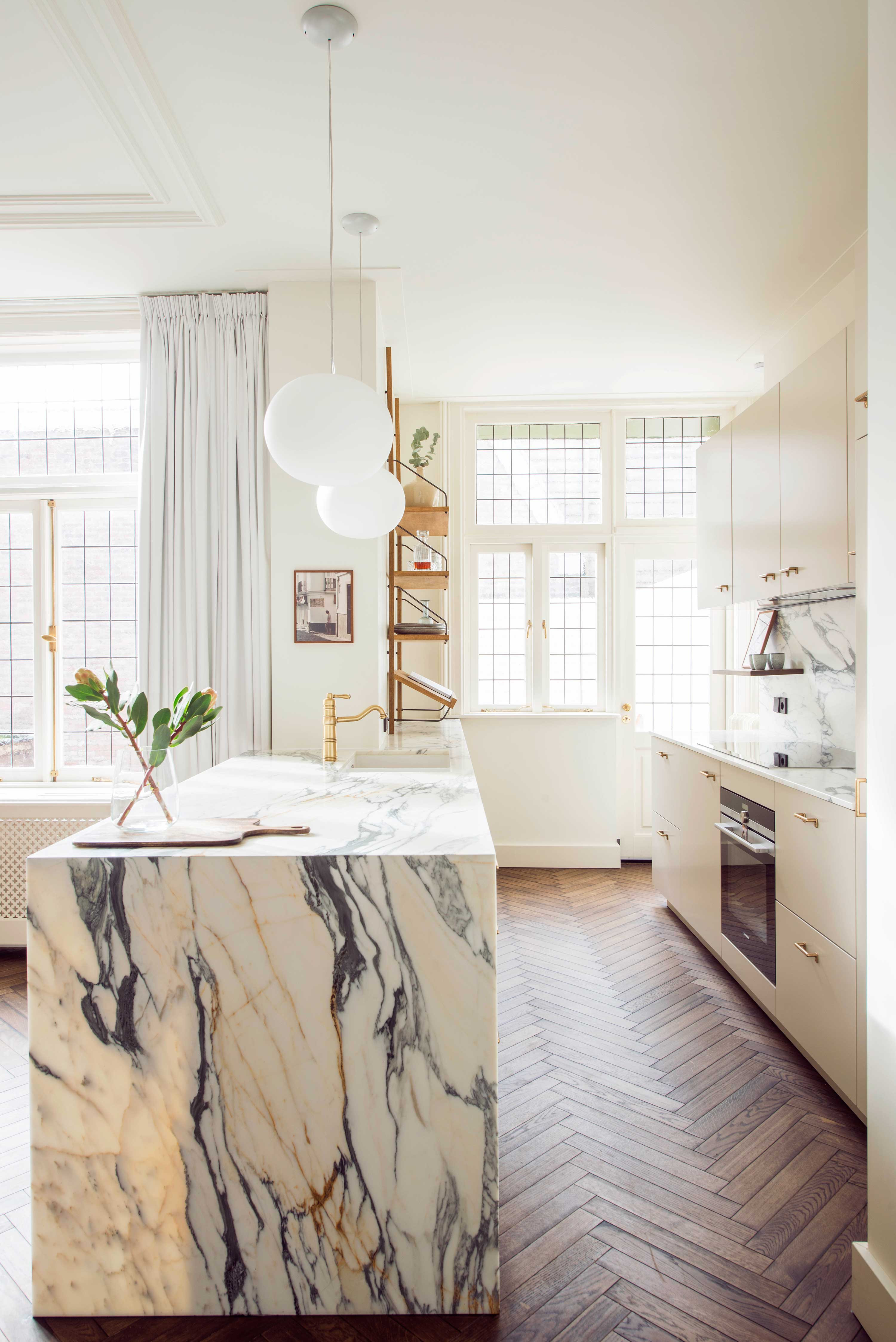 kitchen design studio34 south haarlem residence interior design oak shelving styling marble kitchen wood herringbone flos light light white bright